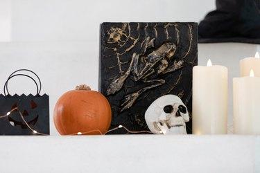 halloween decor on mantel with twinkle lights