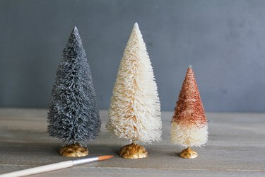 whimsically painted trees made from bottle brushes
