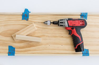 Wood board and power drill