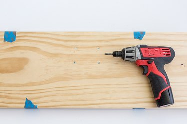 Wood board with power drill