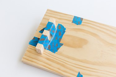 Wood tray with blue painter's tape