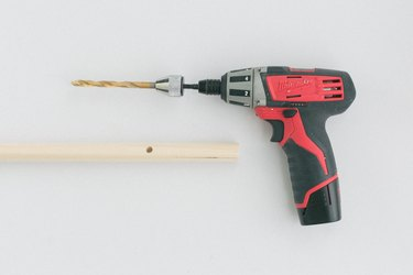 Power drill with wood dowel