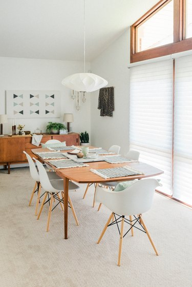 Dining room with large windows mid-century dining furniture and pendant lantern