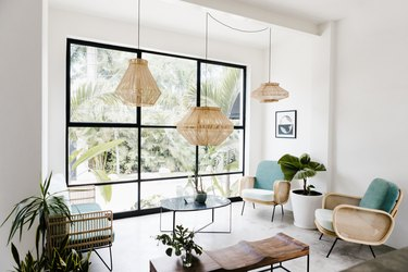 Wicker pendant lights, accent chairs, bench, plants