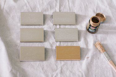 Wood paint sample blocks with paint container and paintbrush
