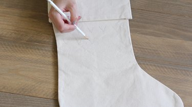 Hand penciling pattern on white stocking