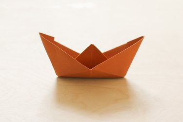 Folded brown paper boat