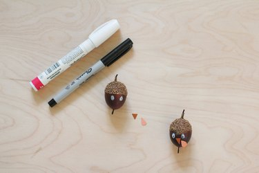 Acorns made into turkeys for decorations with pens