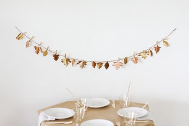 Leaf garland with kids dining table with paper table cloth and disposable dishware