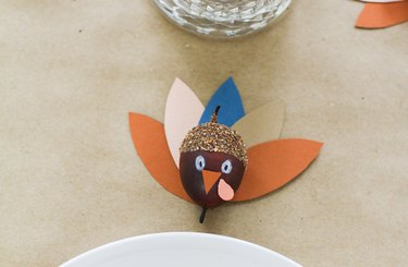 Thanksgiving decoration with multi colored papers and painted acorn