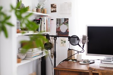 small home office with shelving for books and essentials