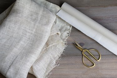 Burlap sheets with gold scissors