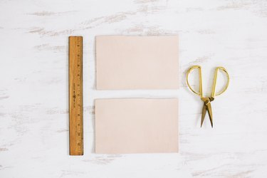 scissors, leather squares, and a ruler