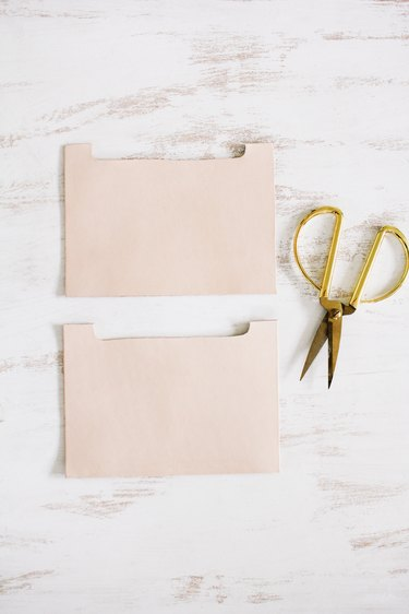 scissors and leather squares  cut for turning into pockets