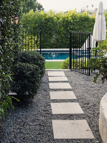 slate walkway on gravel to pool area