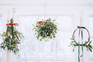 Mistletoe wreath, ball, and traditional hanging cluster all mounted on a ceiing