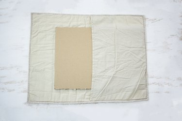 White fabric with cardboard