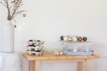 ornament storage with table of containers filled with round ornaments