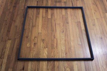 Painted black wood frame