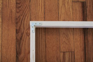 Wood frame with metal flat brace
