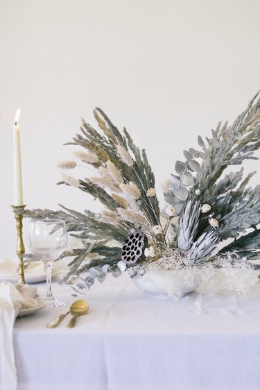 Glittery dried flowers and grass painted gray for Christmas centerpiece