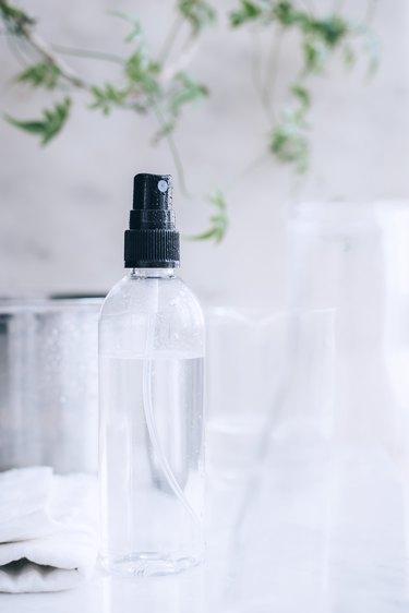 a small spray bottle full of vinegar