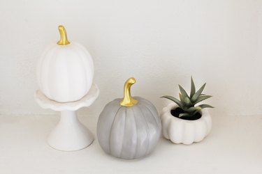 white and  silver ceramic pumpkins and a white pumpkin planter