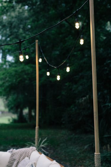Outdoor string lights with wood poles