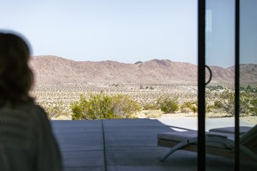 a view through a window of desert and mountains