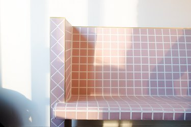 a bench made of small square lavender tiles