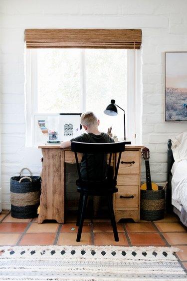 Boy at his desk