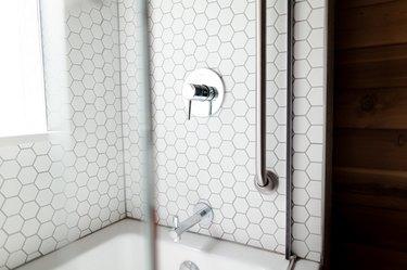White hexagon tile in shower