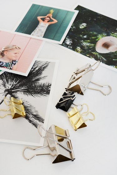a collection of square photographs and binder clips