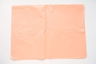 Pink tissue paper against a white background