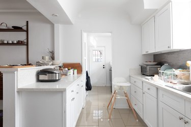 two-tier kitchen peninsula in white with white cabinets