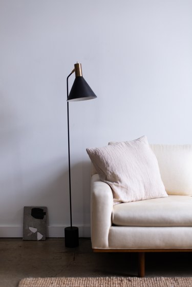 white couch and black floor lamp