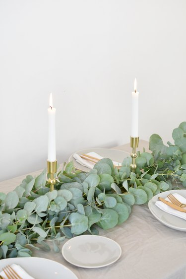 a table runner made from bunches of eucalyptus for Christmas decorations list