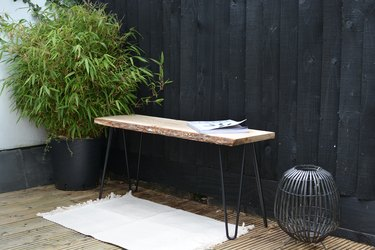 Outdoor rustic wood bench with hairpin legs