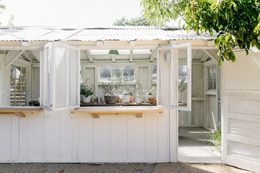 home exterior ideas with white plant shed
