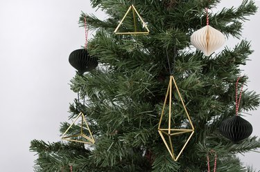 Tree with geometric gold twig ornaments and paper ornaments