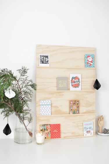 holiday cards sit on shelves made from thin strips of moulding glued to a plywood sheet