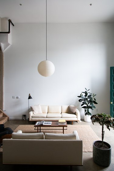 mid-century modern white living room with round pendant light