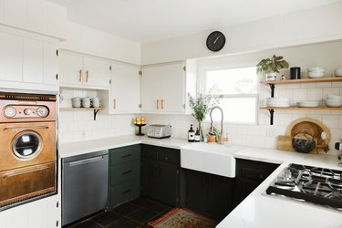 White and green kitchen with white farm sink and copper midcentury oven