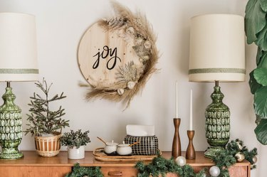 Christmas wood Joy sign with dried plants and midcentury decor