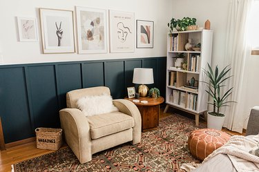 Living room with a blue board and batten wall, neutral and white furniture and decor