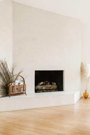 Large white wall fireplace with boho decor