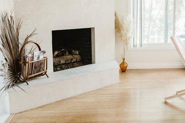 Large white fireplace with boho decor