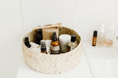 Makeup Organizer Ideas with Basket of beauty product on white bathroom counter