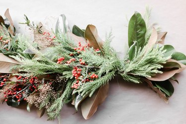 Winter-themed centerpiece with live foliage and berries