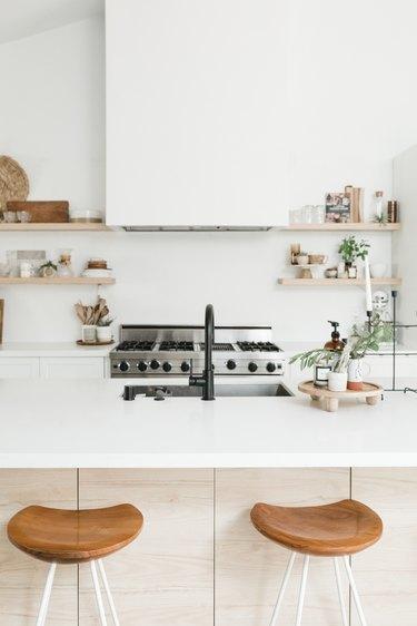 White boho kitchen with large island and professional range